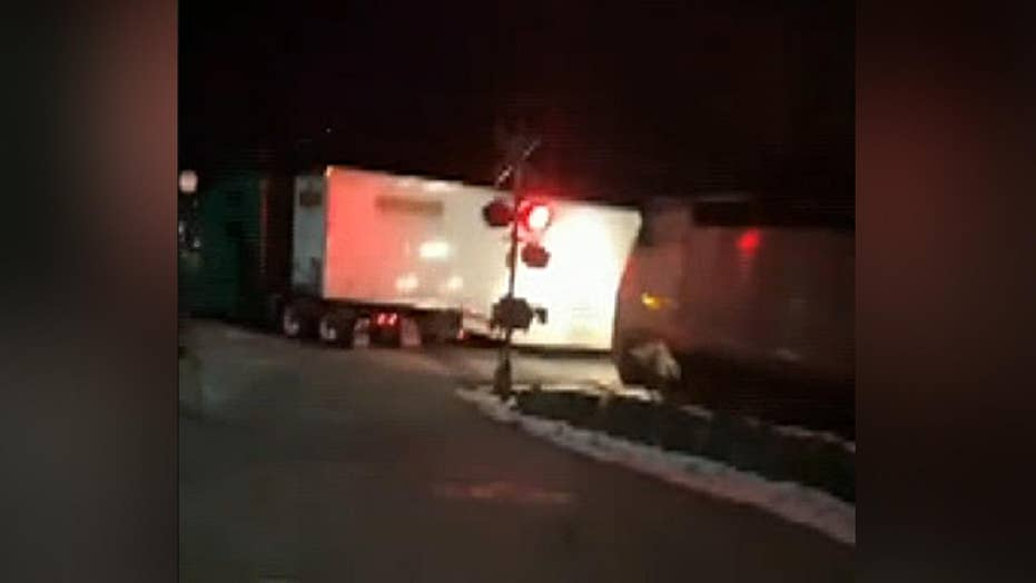 MTA commuter train collides with truck stranded on the tracks in New York