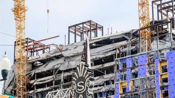New Orleans Hard Rock Hotel dead construction worker's legs seen dangling off collapsed building