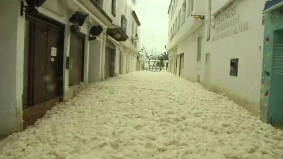 Sea foam floods streets of Spanish town during a deadly storm