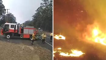 Australia wildfire overruns firefighters in minutes as 'day turns to night' in dramatic video