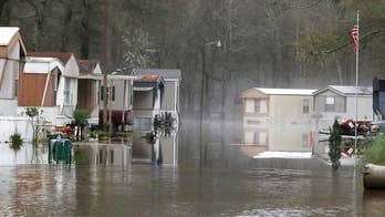 Floodwaters swamps mobile homes in Mississippi