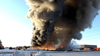Fire at Minnesota recycling facility burns for third day