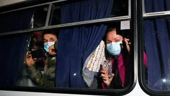 Protesters attack buses carrying coronavirus evacuees