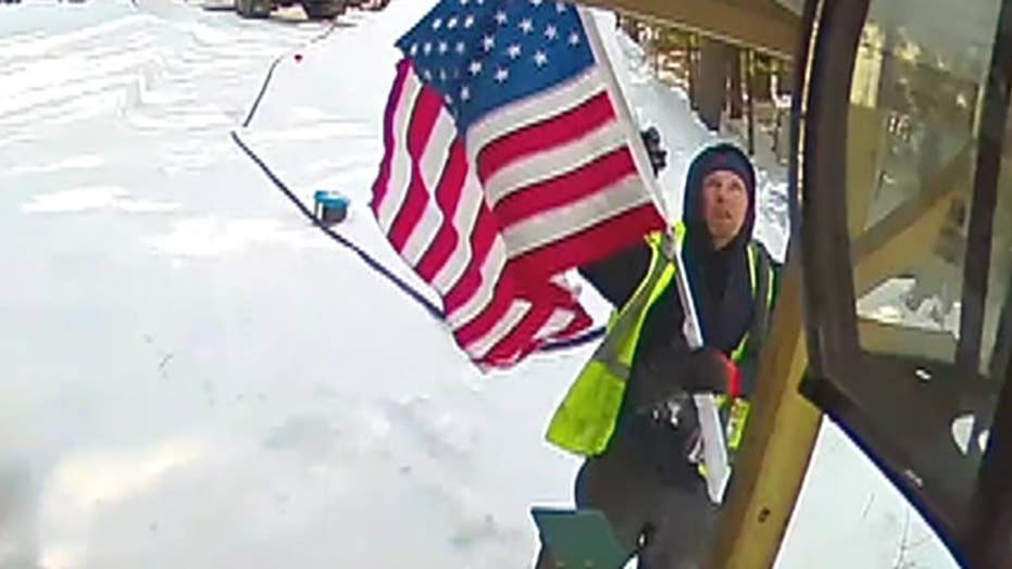 Propane deliveryman in Maine trudged through the snow to fix a fallen American flag