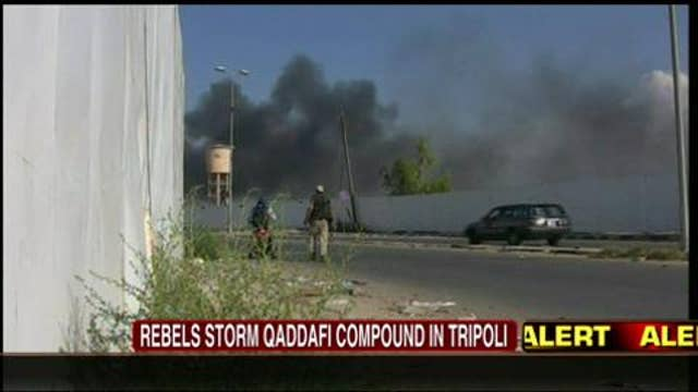 VIDEO: Steve Harrigan Ducks to Avoid Gunfire in Tripoli as Rebels Storm Qaddafi Compound
