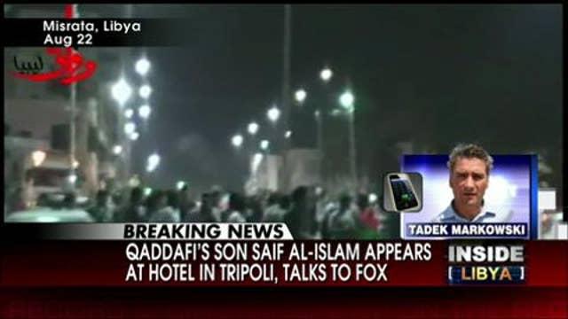 Qaddafi Son: 'He Is Here'