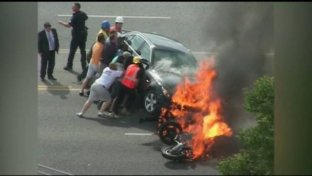 VIDEO: Motorcyclist Trapped Under Burning Car