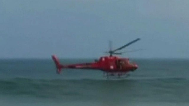Rescue helicopter crashes into ocean