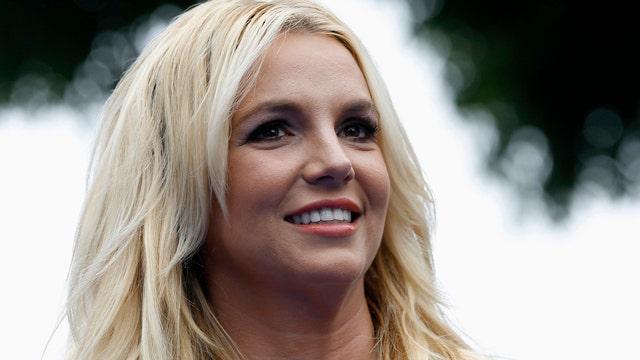 Britney makes boy toy bark