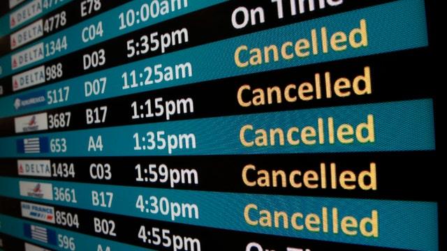 Powerful winter storm snarls travel nationwide