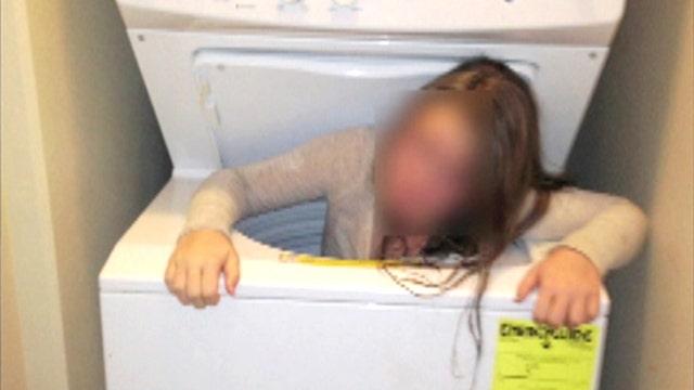 Oversized load: Tween gets stuck in washing machine