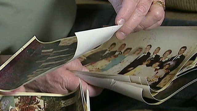 Volunteer group restores photos for Sandy victims