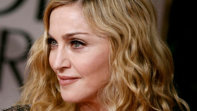 Madonna lets young son drink alcohol?