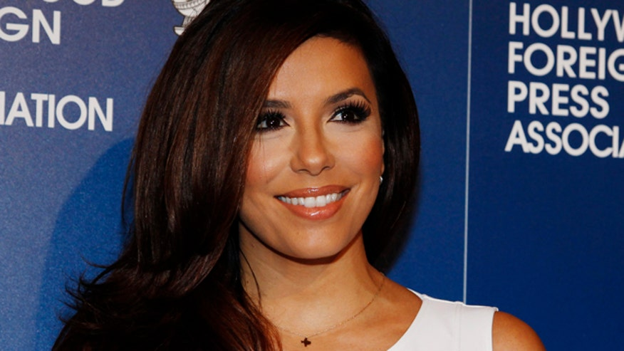 Maxim named Eva Longoria their 2014 Woman of the Year. That was fast!
