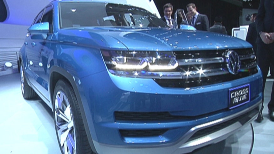 VW Pres and CEO Jonathan Browning introduces the CrossBlue seven passenger plug-in diesel hybrid SUV