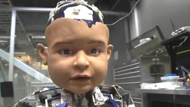 Robot baby learns how to express human emotions