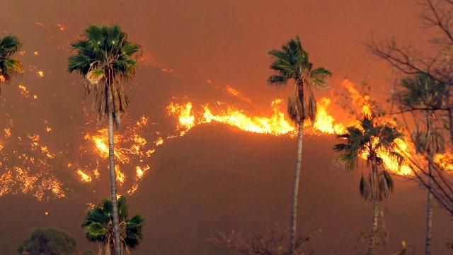 California wildfire dies down as police hold 3 in custody