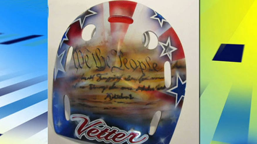 Jessie Vetter's mask repainted to comply with International Olympic Committee rules