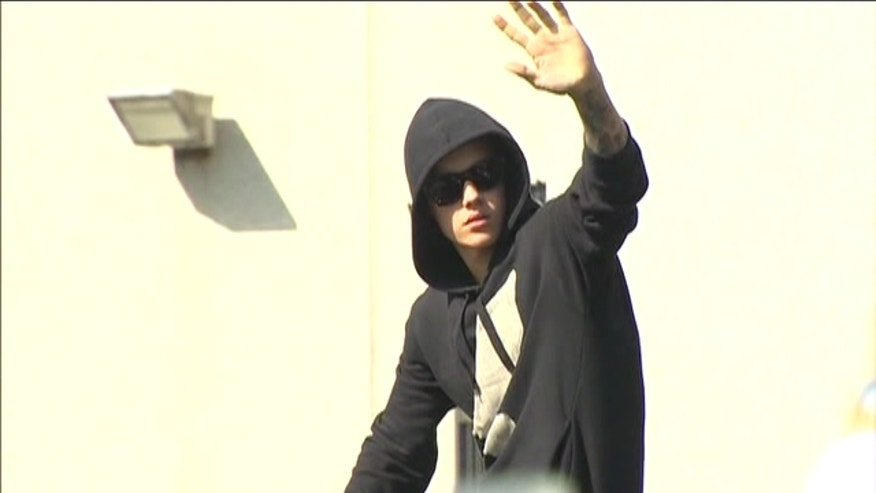 Justin Bieber walked out of jail following his arrest earlier in the day in Miami Beach on charges including driving under the influence and resisting arrest.