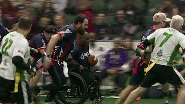 Brian takes the field with wounded warriors
