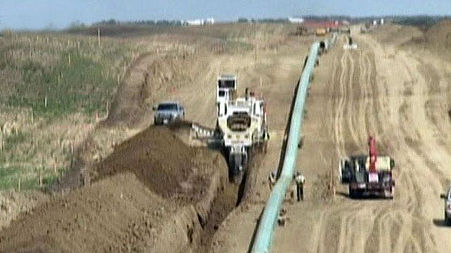 Keystone review mutes environmental concerns, raises pressure on Obama