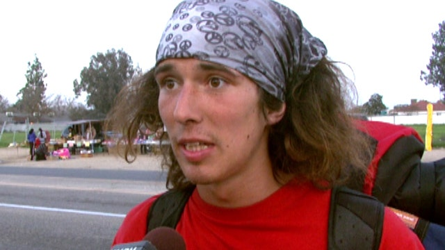 Hero hitchhiker uses hatchet to save woman from 'Jesus'
