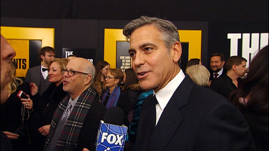 "George Clooney, Bob Balaban, Bill Murray and Matt Damon give Michael Tammero a taste of what he can expect from ""Monuments Men"" at the film's New York premiere."