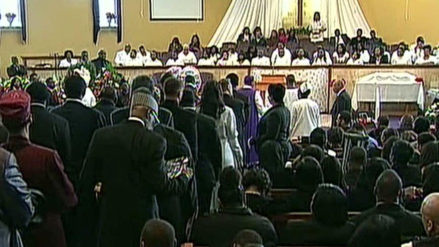 First lady attends Chicago funeral