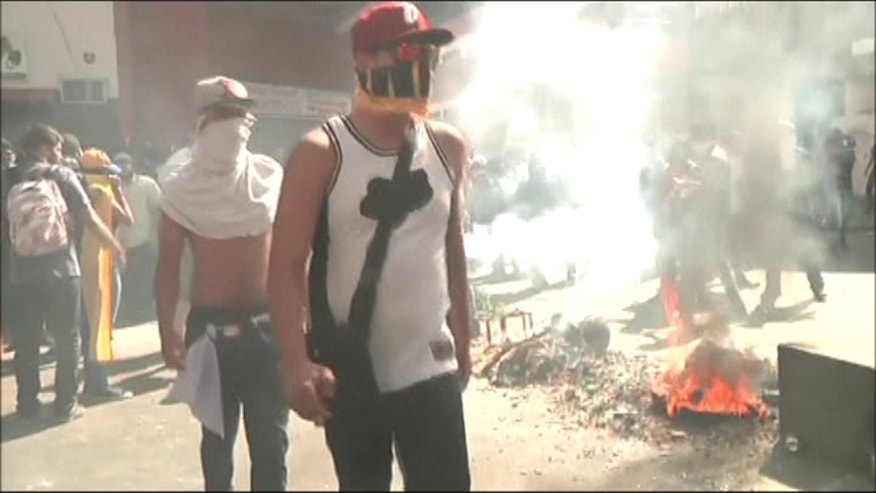 Students and opposition members in nationwide protests against President Maduro's government.