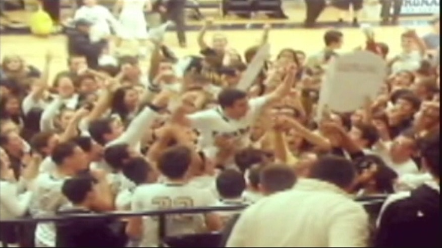 A Texas school rivalry is set aside during a varsity boys basketball game, when both teams cheer for the same player.