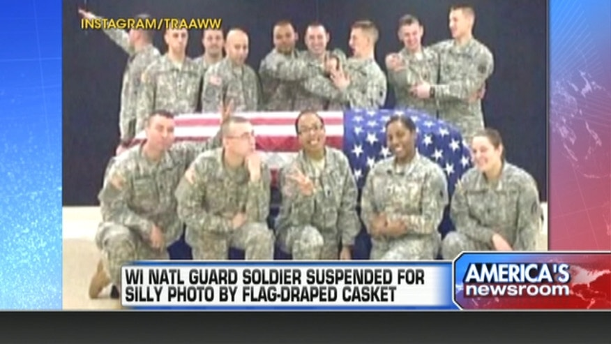 The Wisconsin National Guard has suspended one of its members amid an uproar over photos that appeared on social media apparently making fun of funerals for fallen soldiers.