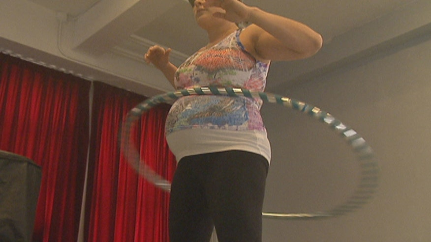 Hoopnotica hoop dancing is an exercise trend showing women that pregnancy is no reason to bump fitness out of their routine