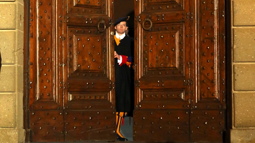 Bells ring, Castel Gandolfo's doors swing shut and Swiss Guards leave post