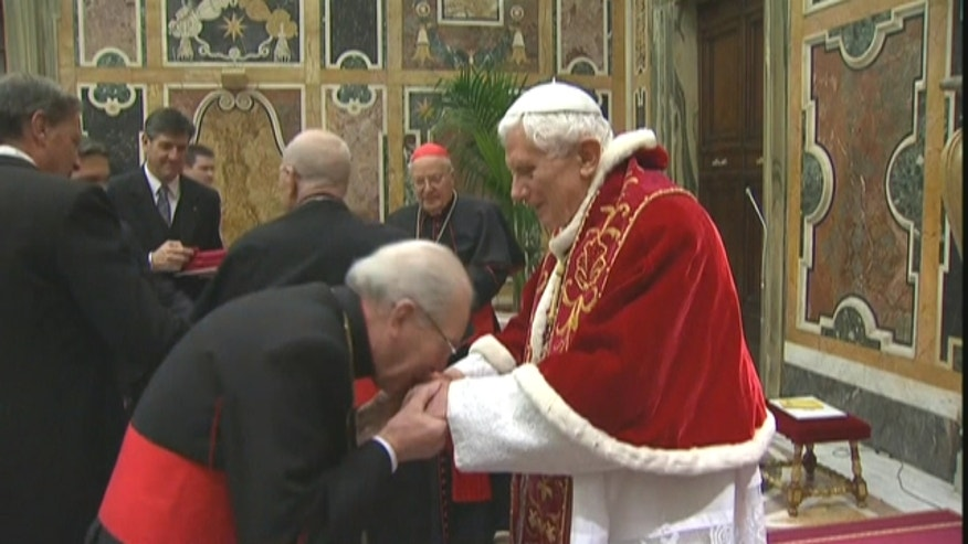 Pope Benedict XVI bids farewell to Cardinals in the Sala Clementine inside the Vatican.
