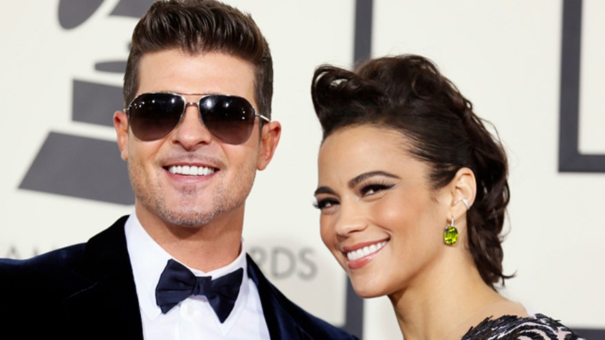 Robin Thicke confessed that he's just trying to get Paula Patton back.