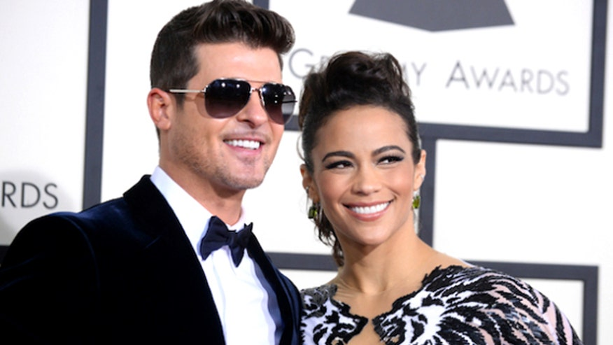 The couple seemed pretty happy, until Thicke got really famous