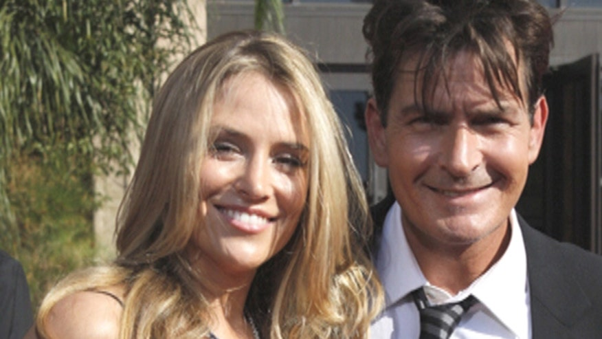 Brooke Mueller threatened anyone who may buy nude photos of her that are reportedly being shopped around.