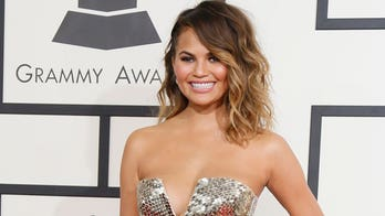 Chrissy Teigen fired back at a critic who said that the married model shouldn't be posting naked pictures of herself online.