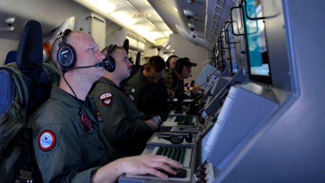 Searchers relying on satellite data to locate missing Malaysia Airlines plane