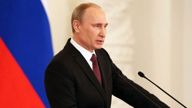 Putin rips West as Crimean leaders sign Russia treaty
