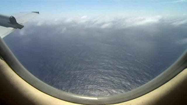 Calmer conditions in new area to help Flight 370 search