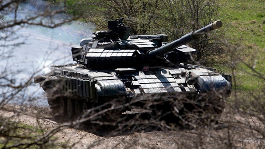 Russian troops said to be hiding positions, creating supply lines near Ukraine border