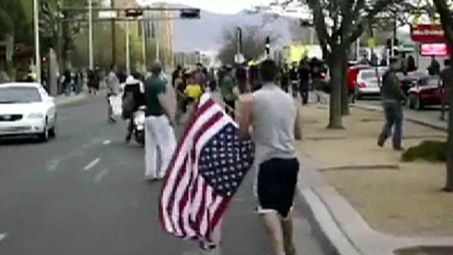 Patriots stop protesters from disrespecting American flag