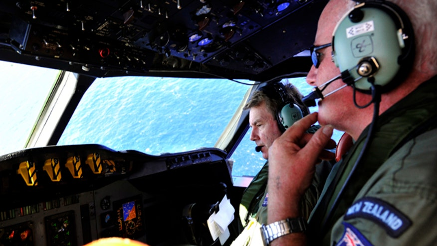 Crews zero in on more targeted area in search for missing plane