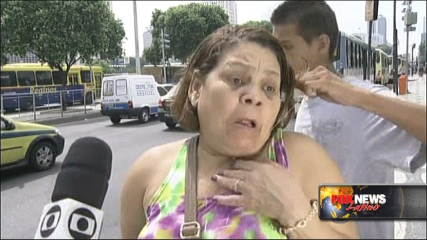 Robber attempts to steal from woman as she is being interviewed about crime on television.