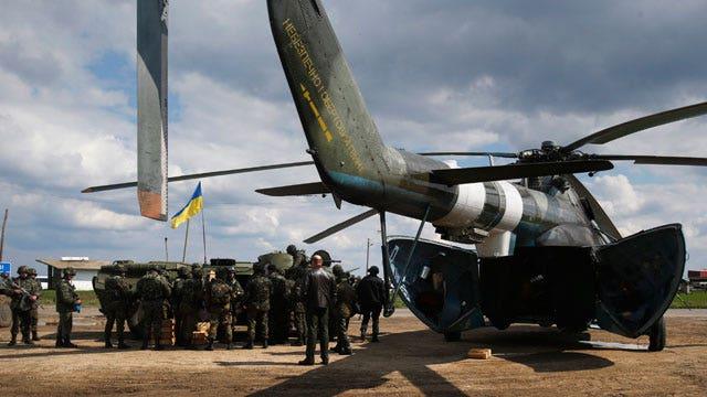 Report: Gunfire heard at Eastern Ukraine airport