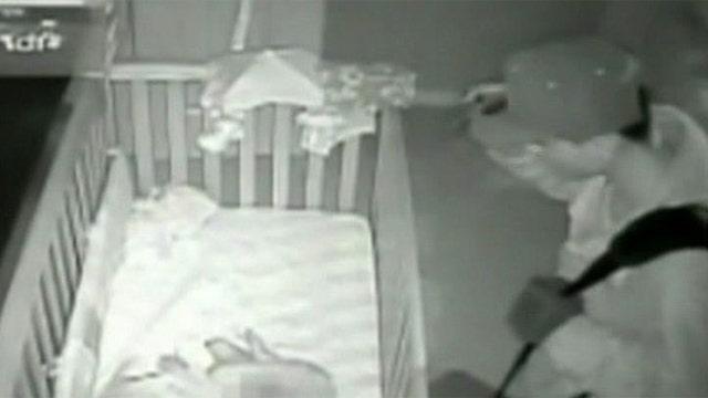 Burglar caught standing over baby's crib