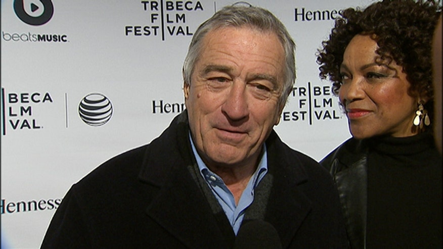 Michael Tamerro interviews Robert DeNiro on the red carpet.