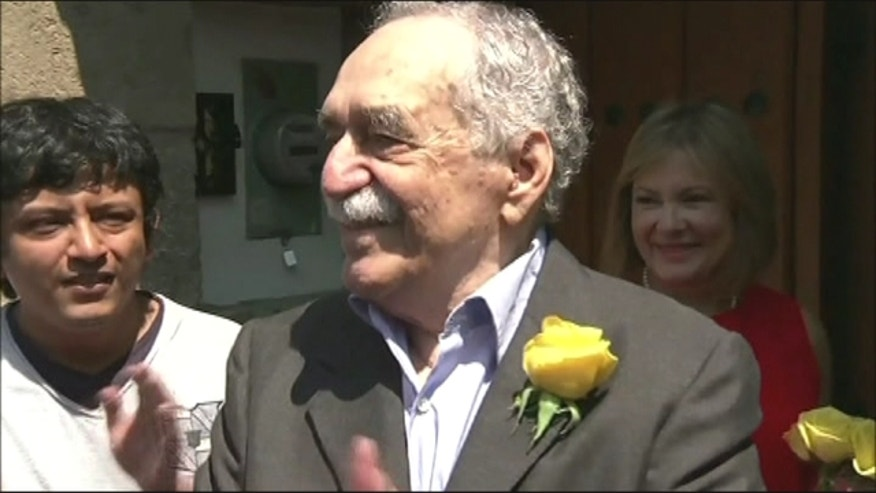 Colombian novelist and Nobel laureate Gabriel Garcia coming out of his home to greet reporters gathered to celebrate his 87th birthday.
