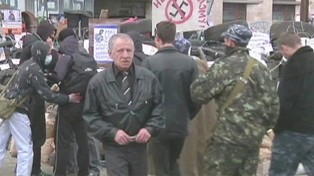 Ukraine claims Russian military, intelligence behind eastern unrest